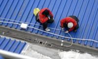 Монтаж кабеля в водостоки