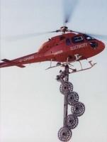 Вертолет с пилой для очистки ЛЭП от растительности